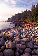 Lots of boulders rest on the shore near Otter Cliff in Acadia National Park.